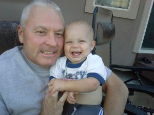 Mark, my protective brother, and his cute grandson, Logan